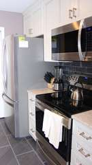 New appliances and stylish tile flooring and backsplash are highlights.