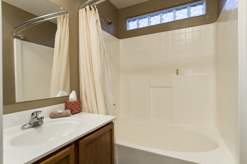 Master bathroom with garden tub and a private toilet area.