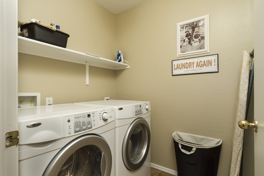 Laundry room with front loading washer and dryer