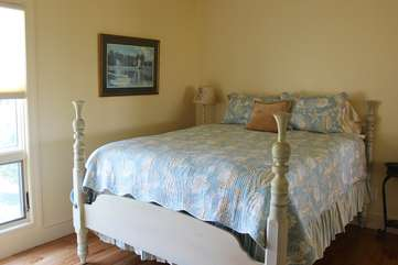 The 2nd bedroom has a queen bed. Large windows offer views to the dunes/water.