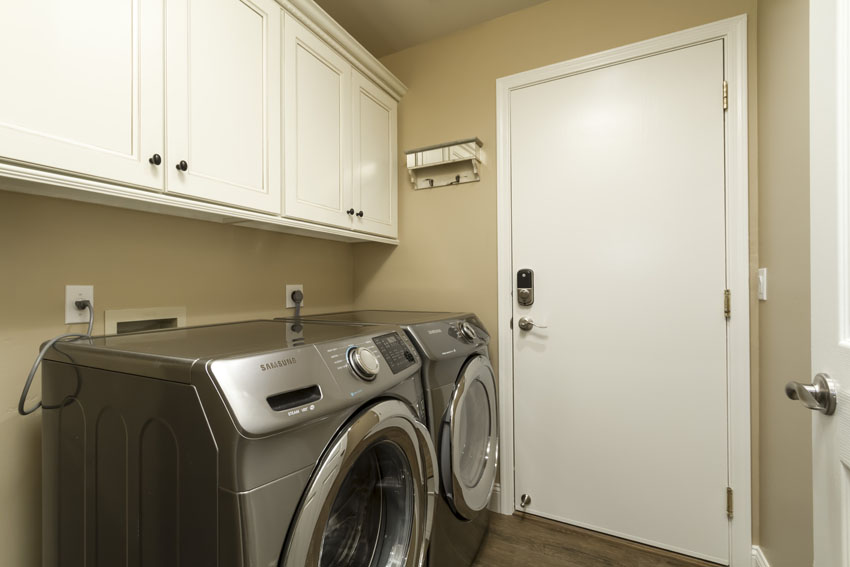 New front loading washer and dryer in the laundry room.