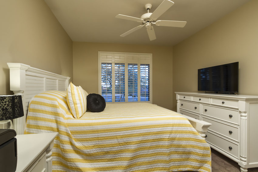 Guest bedroom #3 has a queen bed and a flat screen TV.