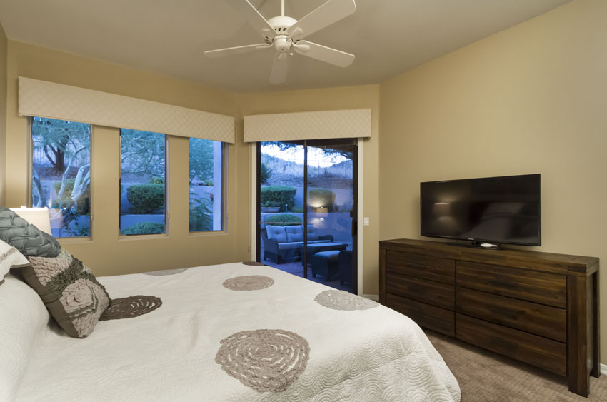 Master bedroom has a 50-inch flat screen TV and a dresser.