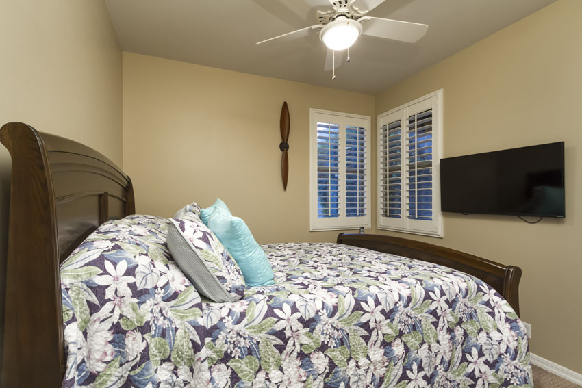 Guest bedroom #2 is split from the master and has a queen bed and flat screen TV.