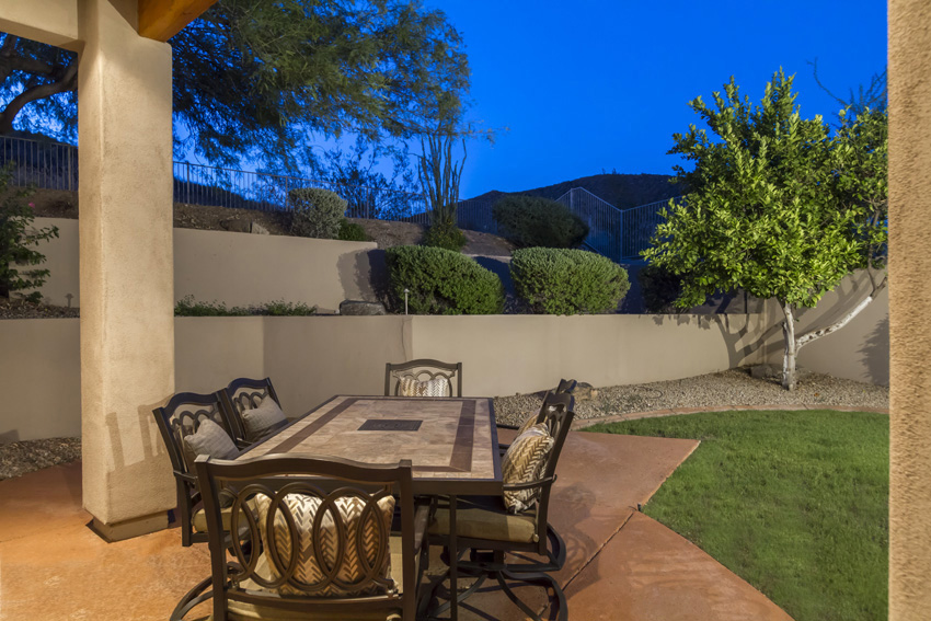 East patio with table for six people. Enjoy the morning sun, mountain views, green grass and citrus trees.