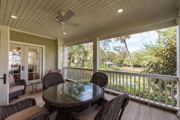 Enjoy reading or gather around the table on the screened in porch for Happy Hour.
