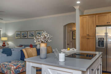 The kitchen is integrated into the great room so everyone is included in the fun.