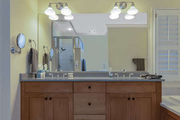 The updated master bath has a double sink, separate shower and a large soaking tub.
