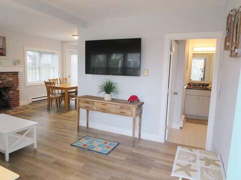 View as you enter the home of living area to dining and 1st floor half bath - 11 Oyster Drive Chatham Cape Cod New England Vacation Rentals