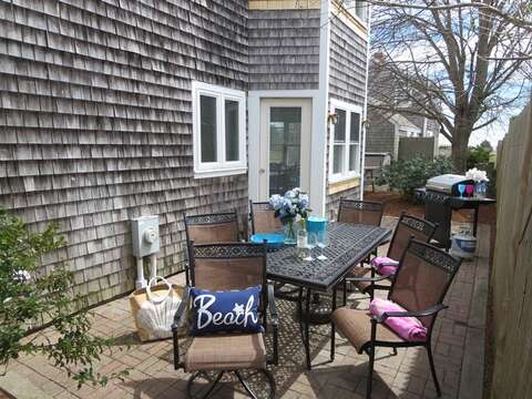 Doors from the dining area open up to back patio which offers a gas grill & table for dining - 11 Oyster Drive Chatham Cape Cod New England Vacation Rentals