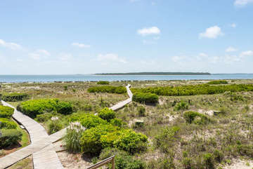 Step off the porch to the boardwalk leading to Pelican Beach.