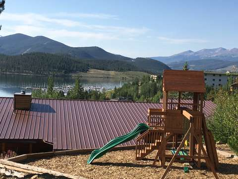 Play set in yard above house with the best lake view!