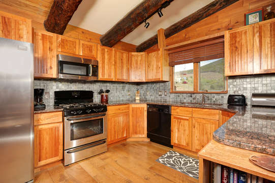 Kitchen has Granite Counters, Stainless Steel Appliances