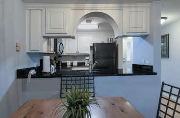 The kitchen opens into the living area making serving meals easy.