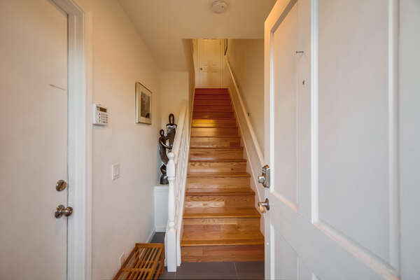 Upstairs to the home, ground level entry