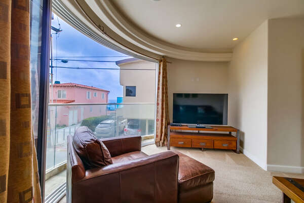 Spacious Living Room Den With a Pull-out couch & Side balcony