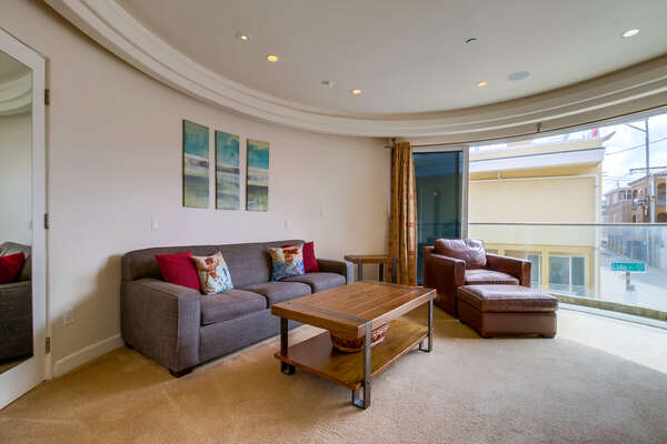 Spacious Living Room with a side patio view