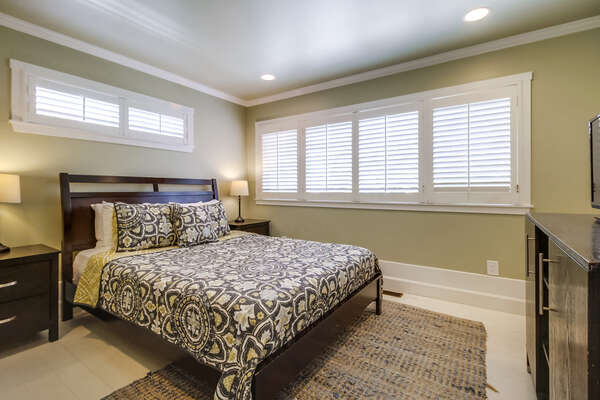 Master bedroom in lower unit, ensuite bathroom