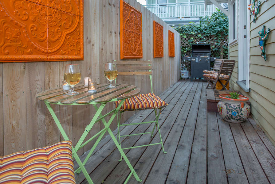 Bistro table, seating and barbecue on back deck