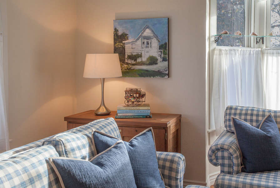 Local art and stagecoach theme throughout the home