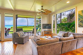 TV area looks out across the lanai to the view
