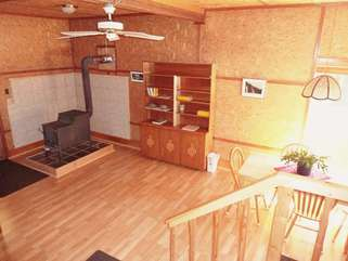 Enter the cabin in this stove room