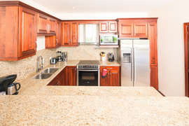 The open kitchen with stainless steel appliances