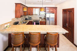 The open kitchen with additional seating at the breakfast bar