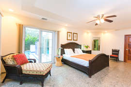 Master bedroom is expansive and has opening to pool and garden