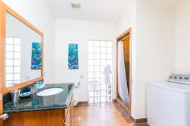 Full bathroom off the kitchen with washer ans dryer