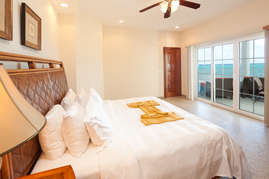 The master bedroom has views of the Caribbean Sea