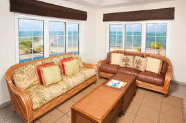 living area overlooking beach and sea