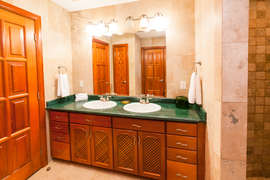 The guest bathroom features a shower and double sinks