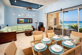 Dining and living room with a wall of glass doors that all open up making it true indoor outdoor living, perfect to feel the ocean breeze