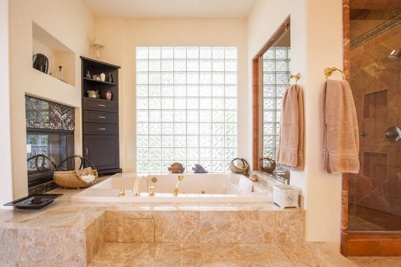 Master bathroom has a separate shower and jetted tub to relax after a busy day