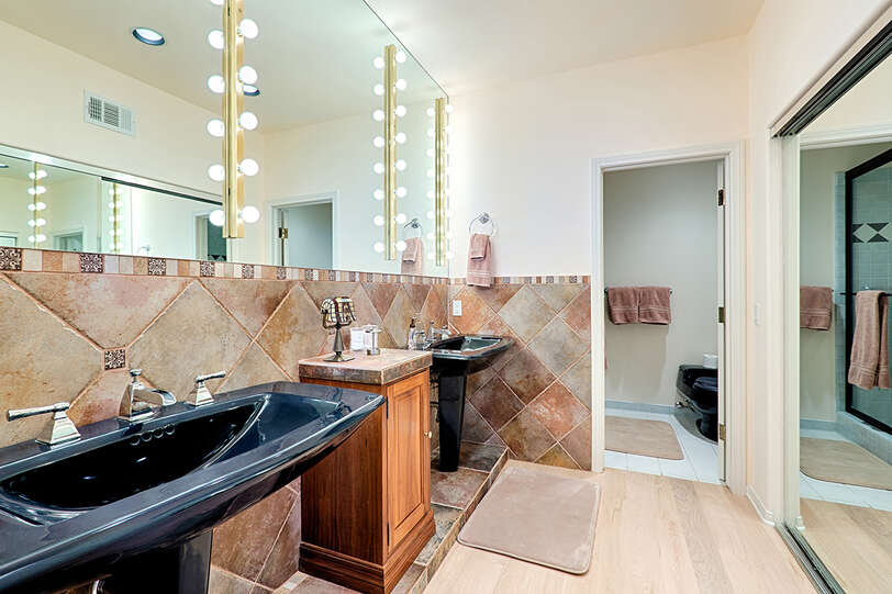 En suite office bathroom has ample closet space and separate shower