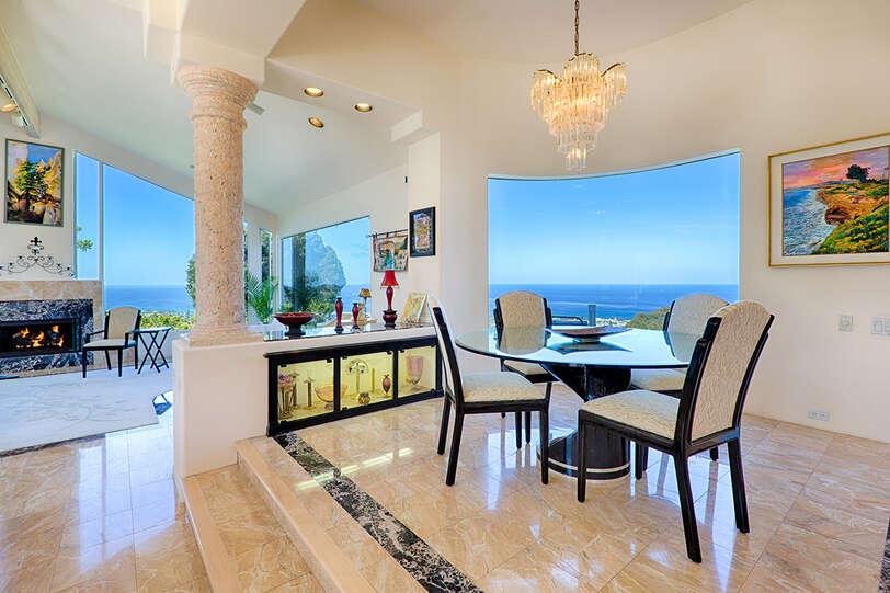 Step up Dining Room adjacent to the Formal Living Room bringing elegance together