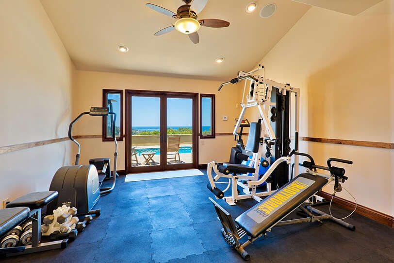 Fully equipped gym with ocean and pool views