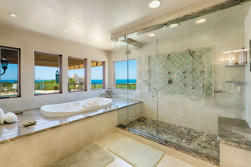 Master bathroom with jetted tub and spacious shower with ocean views
