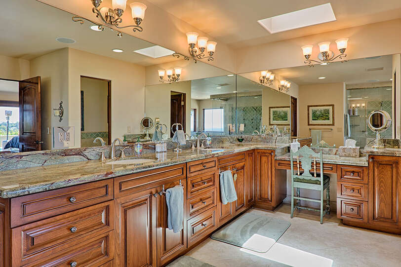 Master bathroom features vanity seating
