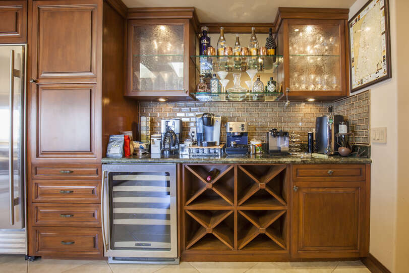 Stocked bar and wine fridge