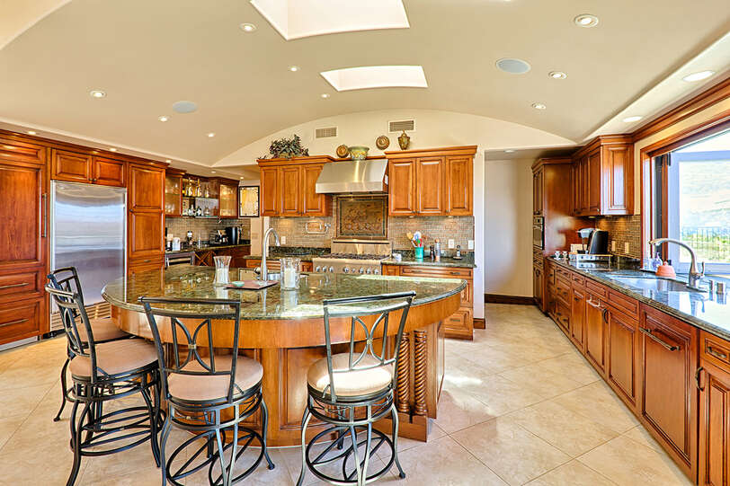Gourmet chef's kitchen with granite counters and every amenity and appliance
