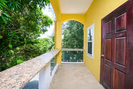 The guest rooms have a private balcony overlooking the Mango trees