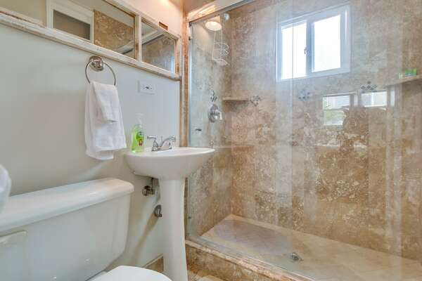 Full Bath with shower only. Window with natural light.