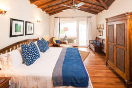 The master bedroom has a private balcony overlooking Half Moon Bay