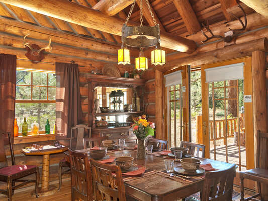 Dining area opens out to a meadow view flagstone patio