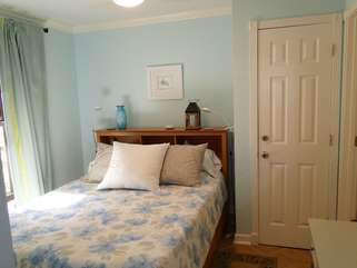 This bedroom has a queen bed with underbed drawer storage for your clothing.