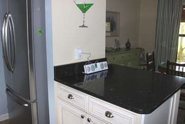 The kitchen allows an easy flow to the living/dining area.