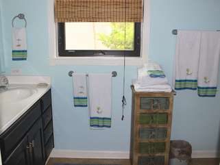 Nicely appointed, it is easy for two guests to get ready in this MBR bathroom.