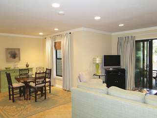 This beautiful villa features tile flooring, new furnishings, & many updates.